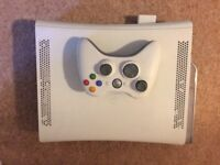 X Box 360 plus wireless controller, 8 games and guitar