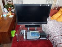 Almost new large glass tv stand. Silver trim.