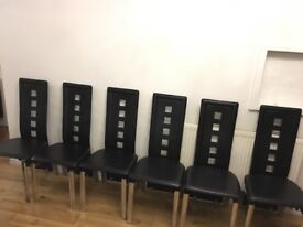 Set of 6 Black leather dining chairs