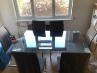 Glass dining table and six chairs in great condition