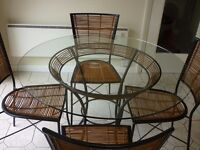 Round Glass Table and 4 chairs - Designer style very unique in new condition