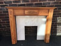 Pine wooden mantle piece and marble back