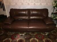 Large brown leather sofas