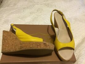 For sale Russell and Bromley yellow leather sandals/wedges