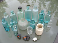 A collection of antique class bottles