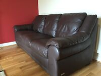 Three seater brown leather effect sofa in good condition