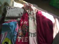 Girls bundle clothes.