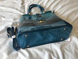 Ladies designer handbag, new. Patent blue. Unused