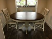 Extendable circular dining table and four chairs American walnut