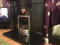 Black marble fire place and gas fire fireplace