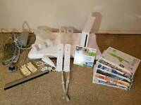 Nintendo wii console with fit board and games