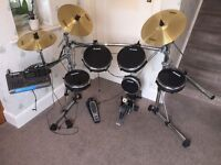 Alesis DM10 Pro Kit Electronic Drum Kit with upgraded Surge brass cymbals and Pearl bass pedal.