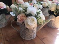 Vintage wedding flowers watering cans