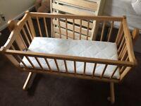 babies wooden crib with mattress