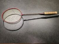 Badminton rackets, both carbon shafted by Carlton, with zipped covers