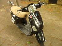 hpi clear piaggio vespa LX50cc black 1 lady owner