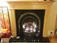 Fireplace: Working gas fire, cast iron insert, granite base, wood effect surround