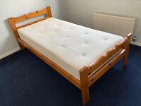 Single wooden bedframe and mattress