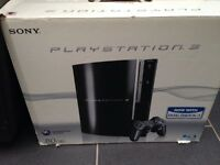 PlayStation 3 boxed with games