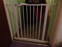 White Lindam baby safety gate.