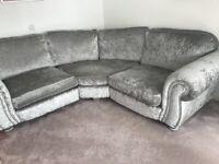 Silver corner sofa with swivel chair