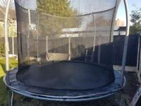 12 ft Trampoline, ladder and enclosure