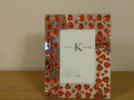 Mirror effect with red hearts picture frame