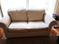 Excellent condition 2 seated beige sofa bed