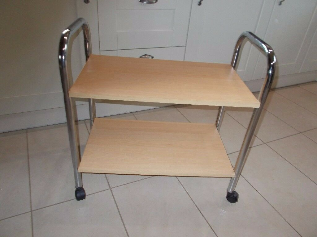 A HANDY TROLLEY TABLE WITH SHELF AND CASTERS IN EXCELLENT CONDITION