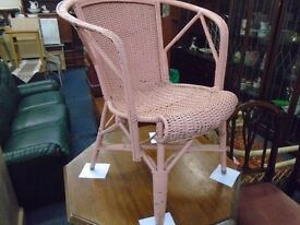 pink hand painted wicker chair.