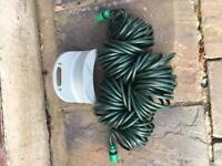 25m expanding garden hose with wall bracket