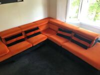 Orange and black corner sofa