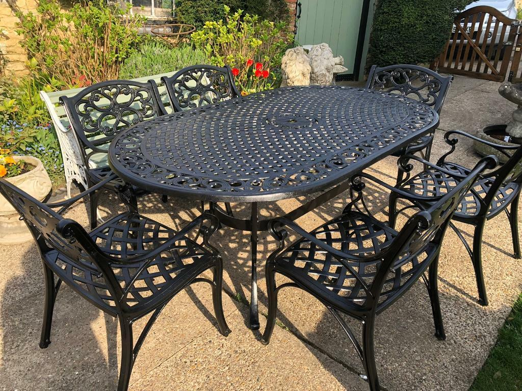 Very large aluminium garden table and six chairs   in ...