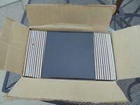 A Box of Black Tiles
