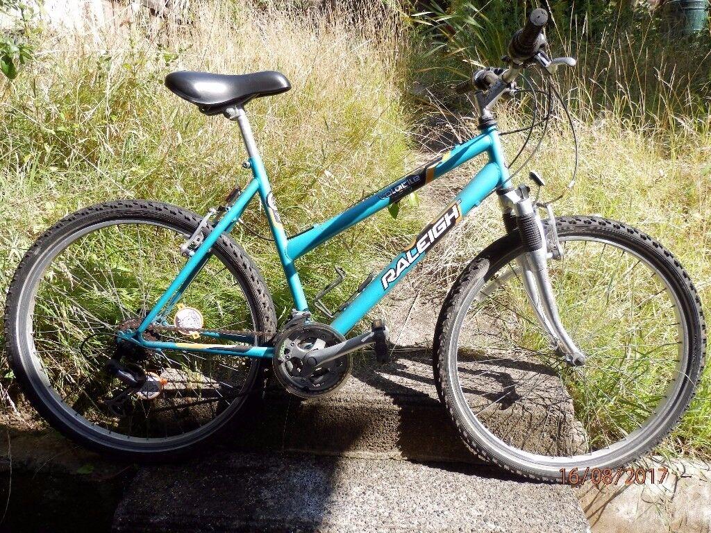 RALEIGH VOLATILE MOUNTAIN BIKE BICYCLE 18 SPEED SHIMANO REVSHIFT GEARS SR SUSPENSION SUNTOUR SHOCKS
