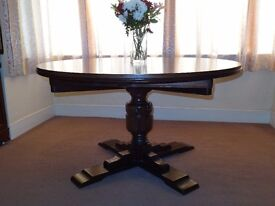 Sturdily made Elm round dining table.