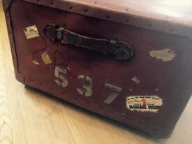 Vintage red storage steamer trunk