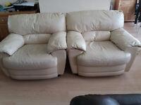 Two white leather single seater sofas
