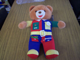 Educational talking Teddy with button, zip, snap, buckle, tie features