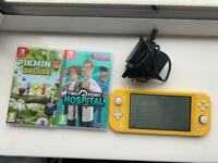 Nintendo switch lite and 2 games