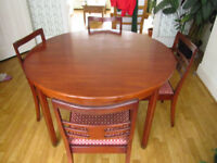 Circular Mahogany extending dining table and four matching chairs by G Plan.
