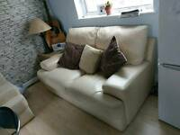 2 cream leather Sofas, two seaters