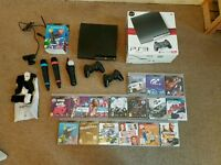 Playstation 3 slim. 16 games. 2 controllers. Ps move and Singstar