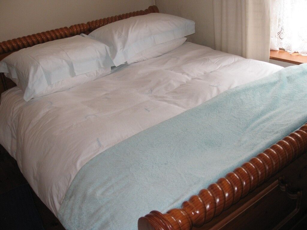 Bed king size with memory foam mattress. Wooden frame in unique design.