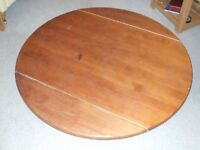 Drop Leaf Round Oak Table 48 inches diameter, 31 inches with leaves down