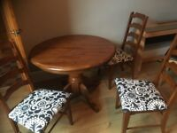 Extendable wooden dining room table and 4 chairs