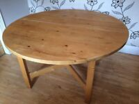 PINE EXTENDING CIRCULAR DINING TABLE WITH 4 CHAIRS