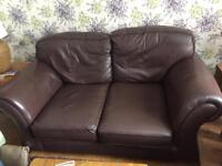 Brown real leather two seater sofas