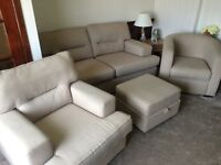 Immaculate suite with 2 seater settee, 2 single chair and large footstool with storage capacity