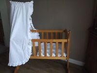 Solid Pine Swinging Crib with pretty white bedding